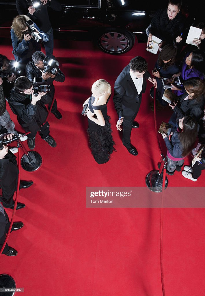 Celebrities working on red carpet : Stock Photo