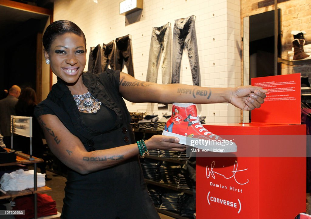 """Celebrity Activist and Runner  Suzanne """"Africa"""" Engo Arrives At Converse Opening Wearing New Damien Hirst Converse Red AIDS Sneaker"""