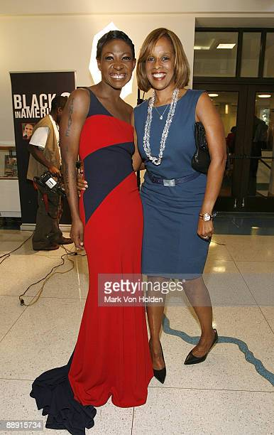 Celebrity Activist Suzanne Africa Engo CNN Exclusive Red Carpet Correspondent wearing Marc Bouwer Collection poses on the red carpet with Editor at...