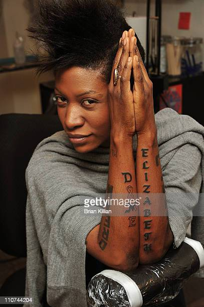 Celebrity AIDS activist Suzanne Africa Engo tattoos Dame Elizabeth Taylor's name in honor of her contribution to HIV/AIDS on March 23 2011 in New...