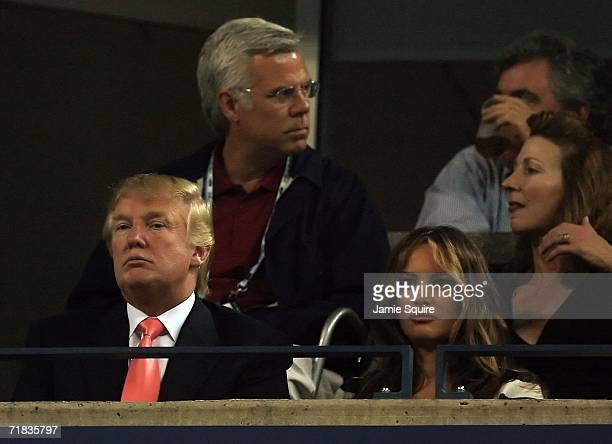 Celebrity and developer Donald Trump and his wife Melania watch the match between Maria Sharapova of Russia and Justine HeninHardenne of Belgium...