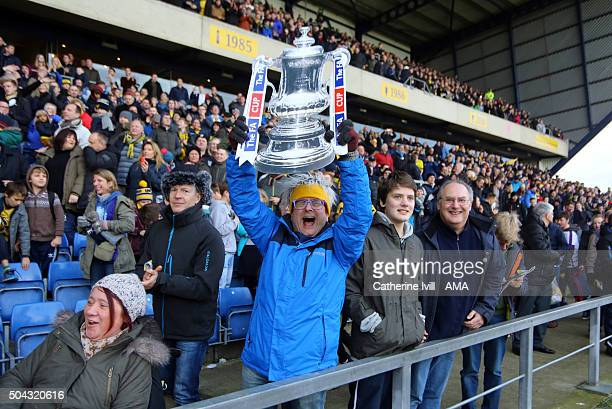 Celebrity and Oxford United fan Timmy Mallett celebrates the win with a cardboard FA Cup trophy after The Emirates FA Cup match between Oxford United...
