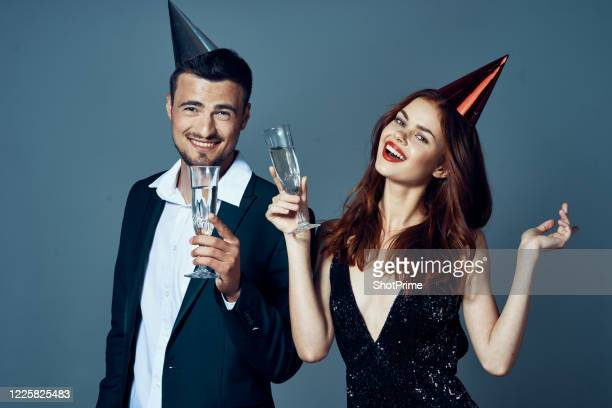 celebrity at a party in an evening dress. young couple holds a holiday with champagne in their hands. - drunk wife at party stock pictures, royalty-free photos & images