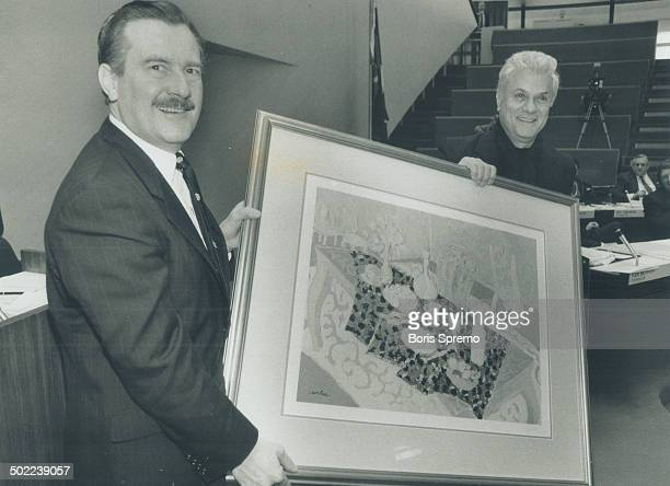 Celebrity at city hall. Actor Tony Curtis, visiting Toronto City Hall yesterday, presents one of his paintings, Breakfast At Bel Air, to Metro...