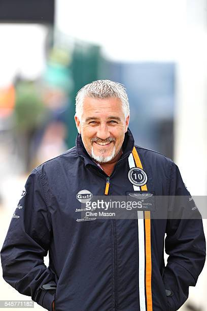 Celebrity baker and TV personality Paul Hollywood walks in the Paddock before the Formula One Grand Prix of Great Britain at Silverstone on July 10...