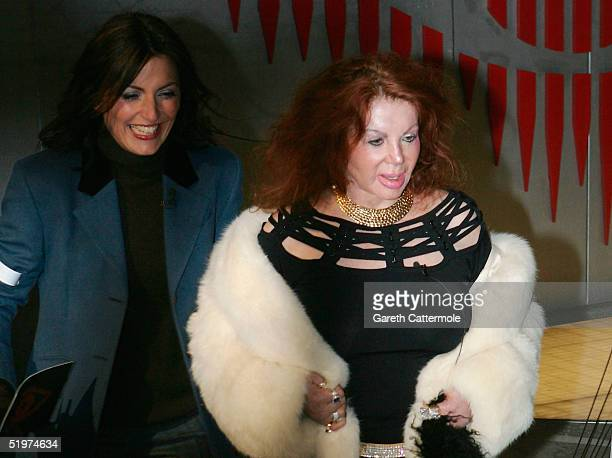 Celebrity Big Brother III housemate Jackie Stallone and presenter Davina MaCall pose for photographs outside the Big Brother house after Jackie was...