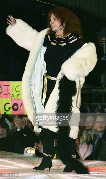 Celebrity Big Brother III housemate Jackie Stallone poses for photographs outside the Big Brother house having been the first celebrity to be evicted...