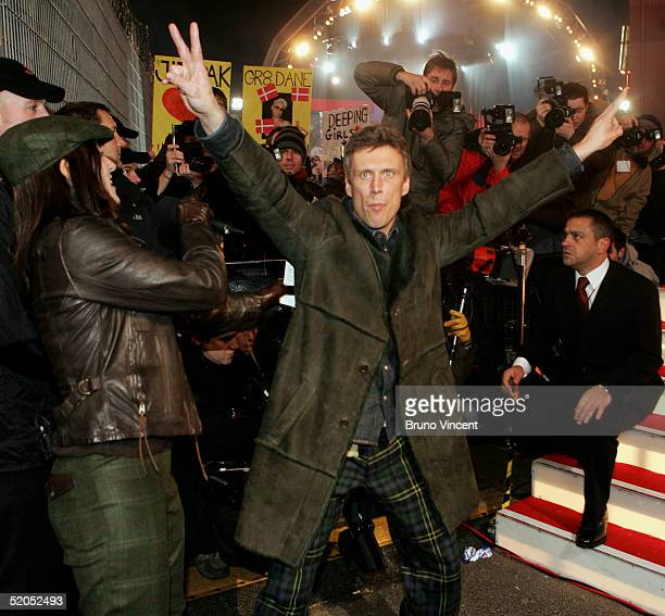 Celebrity Big Brother III winner Bez poses for photographs outside the Big Brother house having been announced the winner of Celebrity Big Brother...