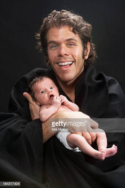 Celebrity blogger and radio host Perez Hilton is photographed with his son for Los Angeles Times on March 17 2013 in Los Angeles California PUBLISHED...
