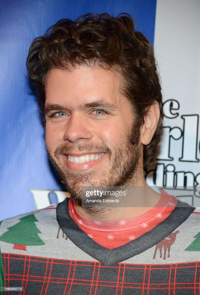 Celebrity blogger Perez Hilton arrives at the World Of Wonder book release party/birthday bash at The Globe Theatre at Universal Studios on December 13, 2012 in Universal City, California.