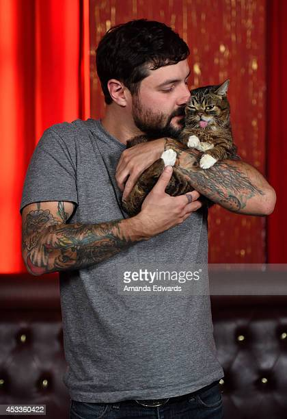 Celebrity cat Lil BUB and her owner Mike Bridavsky attend the Lil BUB meet and greet at The Belasco Theater on August 8 2014 in Los Angeles California