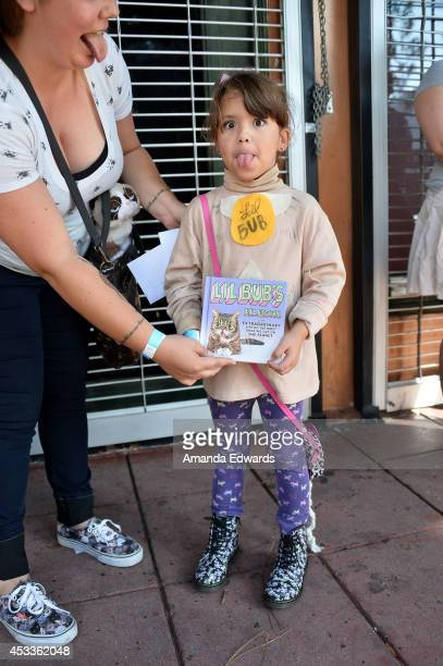 Lil bub meet and greet los angeles ca stock photos and pictures celebrity cat lil bub fan mae brewer attends the lil bub meet and greet at the m4hsunfo
