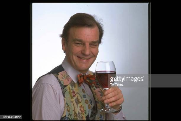 Celebrity chef and television presenter Keith Floyd holding a glass of red wine, circa 1991.