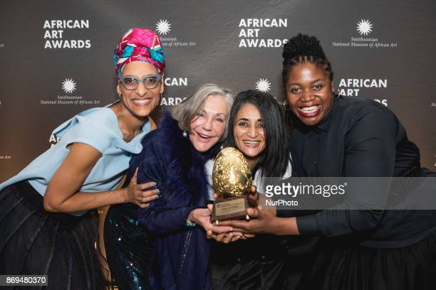 Celebrity chef Carla Hall poses for a photo with honorees and their award philanthropist Alice Walton and artists Ghada Amer and Mary Sibande at The...