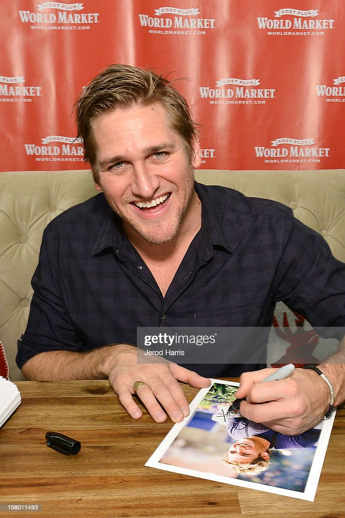 Celebrity Chef Curtis Stone signs autographs for fan at Cost Plus World Market's Share the Joy event at Cost Plus World Market on December 8, 2012 in Los Angeles, United States.