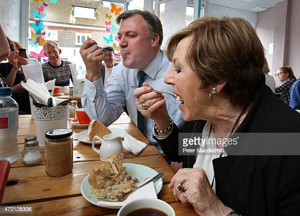Celebrity chef Delia Smith and Labour party shadow chancellor Ed Balls taste some cake at the Pelican on Portland cafe on May 4, 2015 in Hove,...