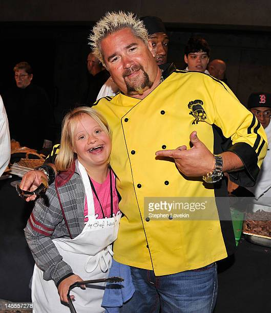 Celebrity Chef Guy Fieri and Lauren Potter cook during the Guy Fieri Celebrity Chef Tailgate Party to KickOff Festivities For The Best Buddies...