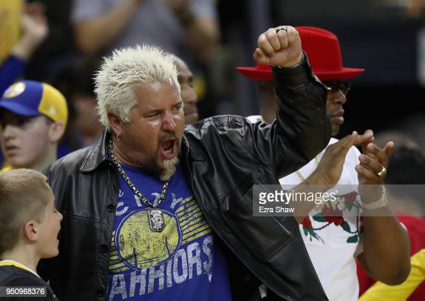 Celebrity chef Guy Fieri cheers for the Golden State Warriors during Game Five against the San Antonio Spurs of Round One of the 2018 NBA Playoffs at...