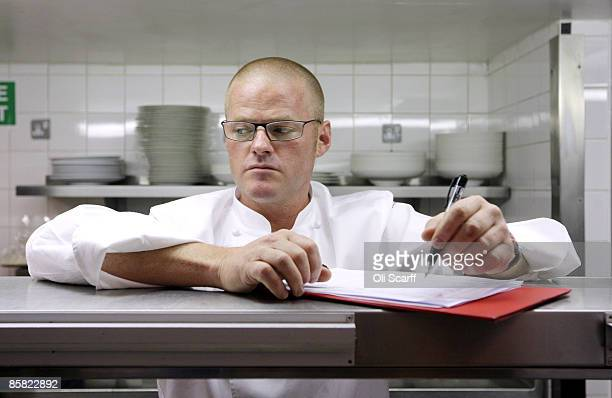 Celebrity chef Heston Blumenthal observes chefs preparing a meal of Brill Cherubin as they compete in the final round to win a 'Roux Scholarship' at...