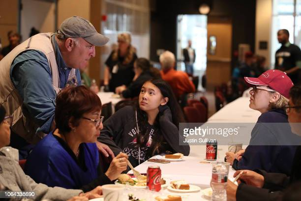 Celebrity chef Jose Andres talks with evacuees during a community Thanksgiving dinner at California State University Chico on November 22 2018 in...