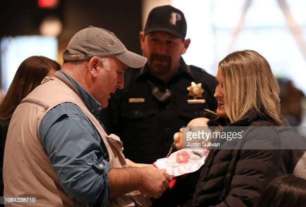 Celebrity chef Jose Andres talks with Paradise police chief Eric Reinbold his wife Logan Reinbold and doughter Hayden during a community Thanksgiving...