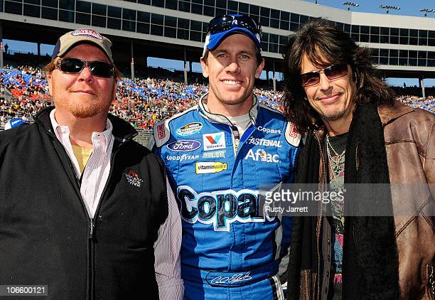 Celebrity chef Mario Batali Carl Edwards driver of the Copartcom Ford and Foreigner lead singer Kelly Hansen pose on the grid prior to the NASCAR...
