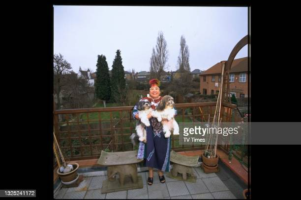 Celebrity chef Nancy Lam photographed on the balcony with her dogs at home, circa 1997.
