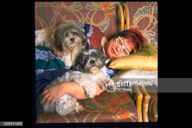Celebrity chef Nancy Lam photographed on the sofa with her dogs at home, circa 1997.