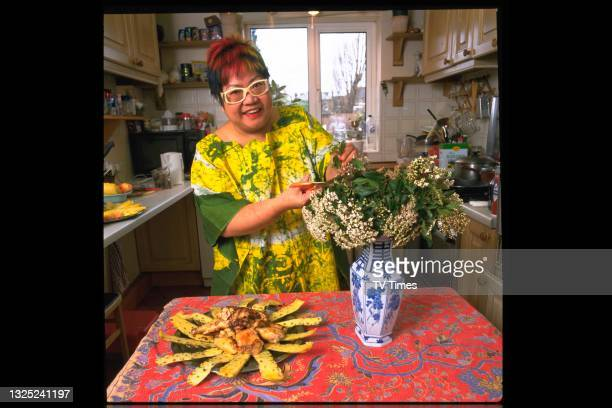 Celebrity chef Nancy Lam photographed preparing a meal in her kitchen at home, circa 1997.