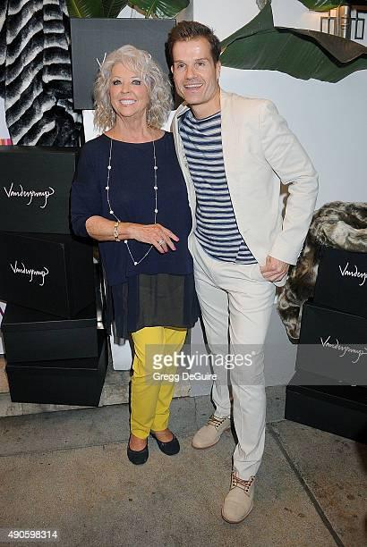 Celebrity chef Paula Deen and dancer Louis van Amstel arrive at the EVINE Live Celebration at Villa Blanca on September 29 2015 in Beverly Hills...