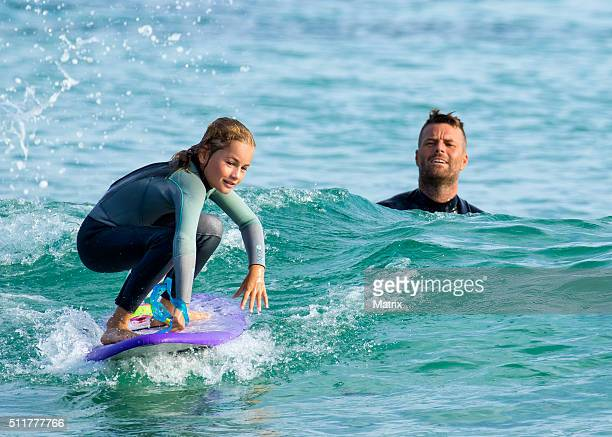 Celebrity chef Pete Evans enjoys a surf at Bondi Beach with daughters Chilli and Indii on February 22 2016 in Sydney Australia