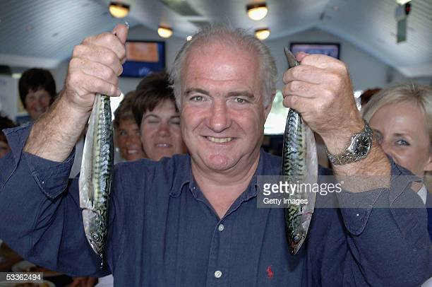 Celebrity chef Rick Stein poses with 16 invited school cooks to learn new ways to cook fresh fish as part of the Cornish Healthy Schools Scheme at...