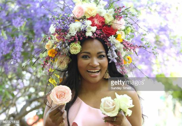 Celebrity chef Siba Mtongana models a headpiece by floral stylist Blomboy ahead of South Africa's second ever Garden Day celebration on October 14...