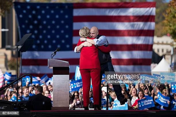 Celebrity chef Tom Colicchio hugs Democratic presidential nominee Hillary Clinton speaks during a rally outside the University of Pittsburgh's...