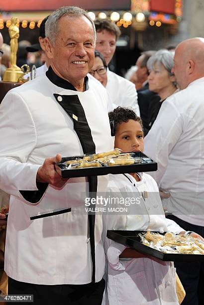 Celebrity chef Wolfgang Puck and his son Oliver arrive on the red carpet for the 86th Academy Awards on March 2nd 2014 in Hollywood California AFP...