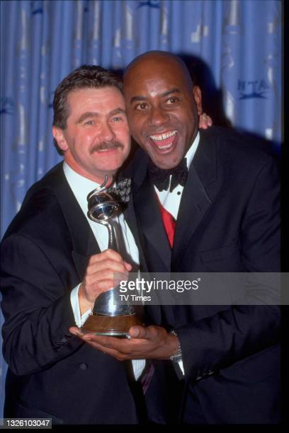 Celebrity chefs Kevin Woodford and Ainsley Harriott at the National Television Awards at the Royal Albert Hall in London on October 8, 1997.