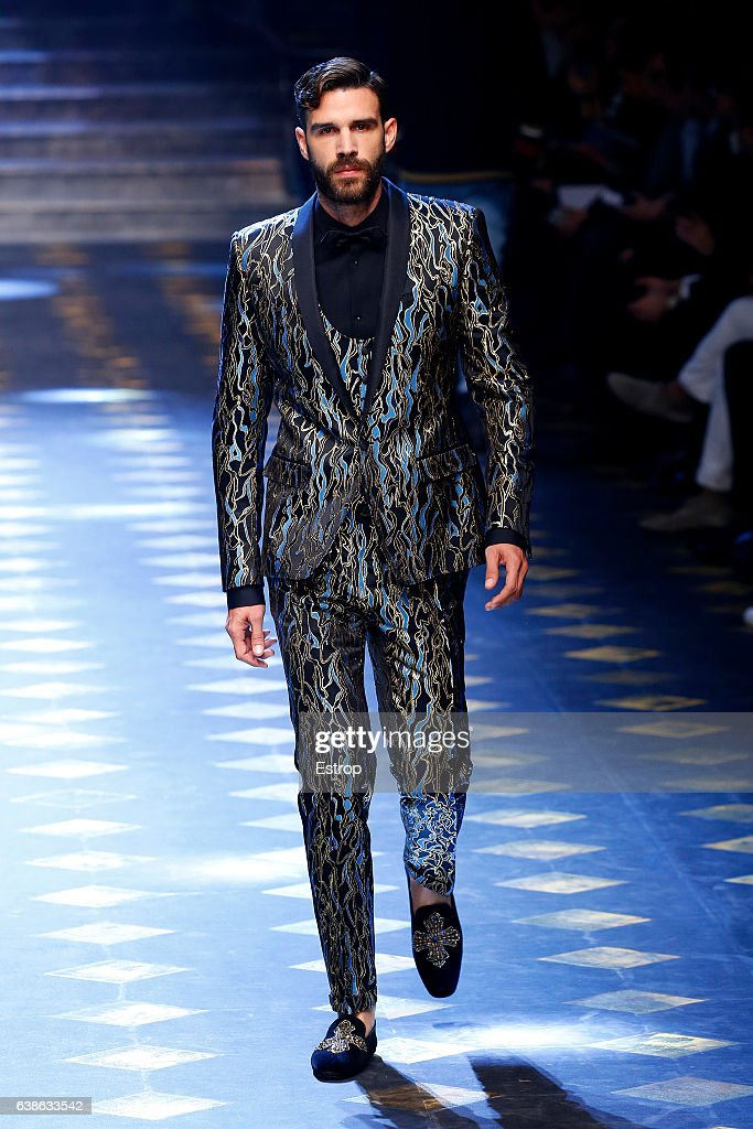 Celebrity Christian Bendek walks the runway at the Dolce & Gabbana show during Milan Men's Fashion Week Fall/Winter 2017/18 on January 14, 2017 in Milan, Italy.