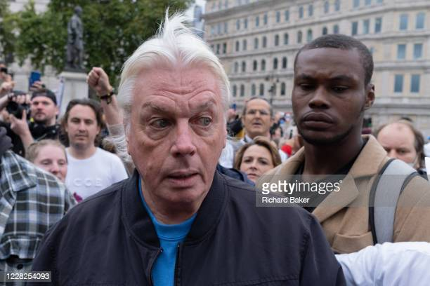 Celebrity conspiracy theorist David Icke is greted by adoring admirers as they gather in Trafalgar Square for an anti-lockdown and pro-personal...