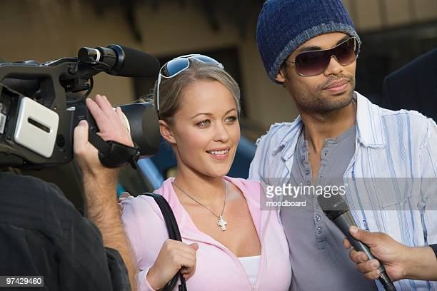 Celebrity couple being interviewed by the media