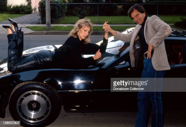 Celebrity couple Josh Taylor and Sandahl Bergman pose for a portrait on their Corvette at their home in circa 1985 in Los Angeles California