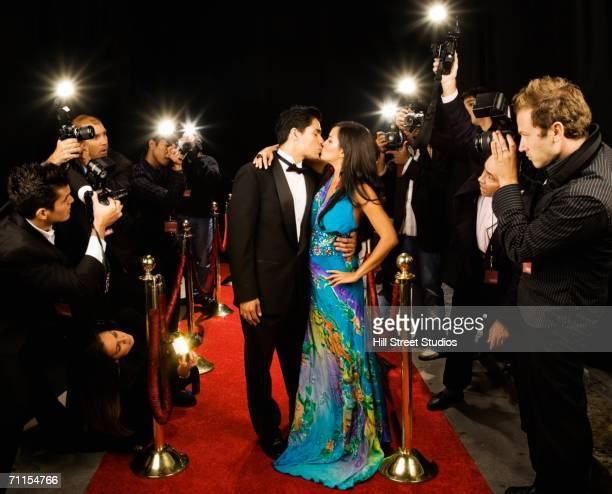Celebrity couple kissing on the red carpet