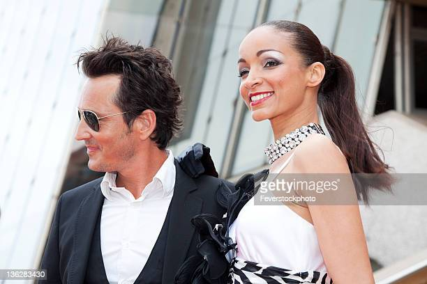 celebrity couple smiling for camera - celebrities stock pictures, royalty-free photos & images