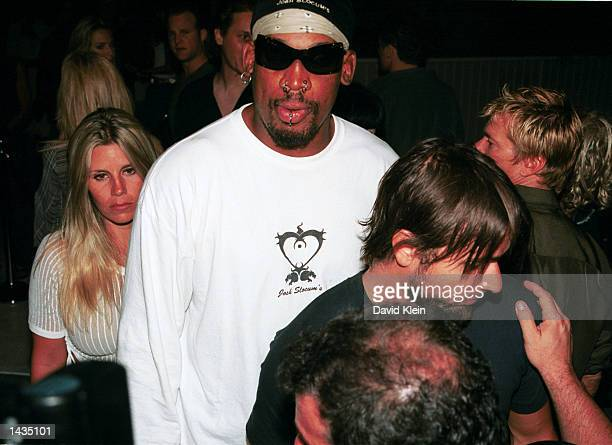 Celebrity Dennis Rodman exits the Standard Hotel with an unidentified woman on September 19 2002 in West Hollywood California