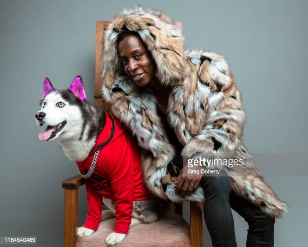 Celebrity Dog Swaggy Wolfdog and actor and model Shaka Smith pose for a portrait as Project Save Our Surf visits TAP The Artists Project on October...