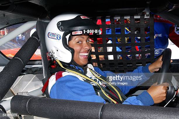 Celebrity driver Adai Lamar poses for photographers during the Richard Petty Driving Experience at the California Speedway on September 1 2005 in...