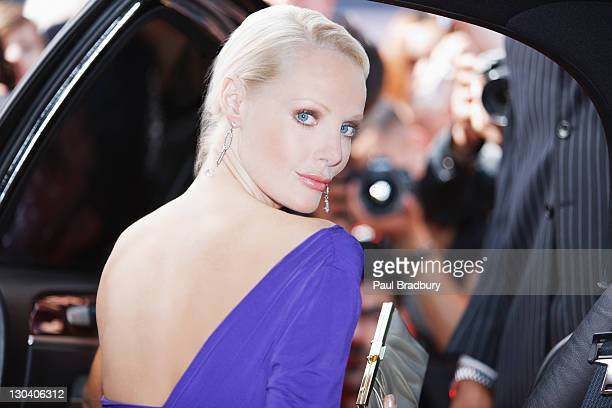 celebrity emerging from car towards paparazzi - fame stock pictures, royalty-free photos & images