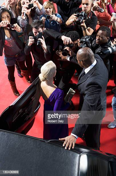 celebrity emerging from car towards paparazzi - celebrity see through clothes stock pictures, royalty-free photos & images