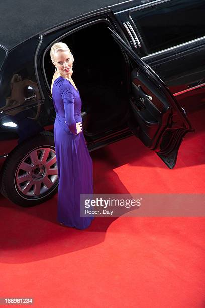 Celebrity emerging from limo on red carpet