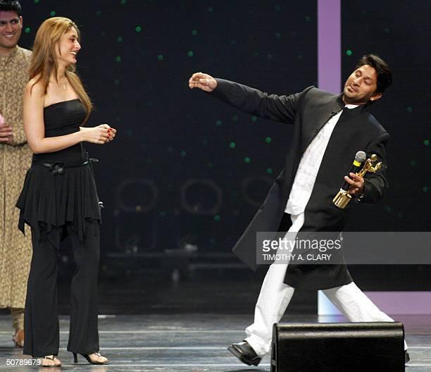 Celebrity Female Style winner Kareena Kapoor is awarded her trophy by presenter Hema Malini during the 2004 Bollywood Fashion Awards at the Trump Taj...