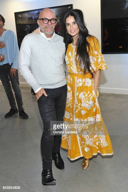 Celebrity floral and fragrance designer Eric Buterbaugh and Demi Moore attend the private opening of Sascha von Bismarck debut photography collection...